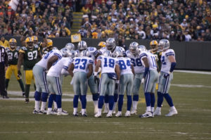 © Wisconsinart | Dreamstime.com - Dallas Cowboys Huddling Up On Game Day Photo